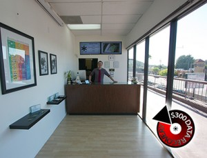 Office manager John Irvine greets customers.