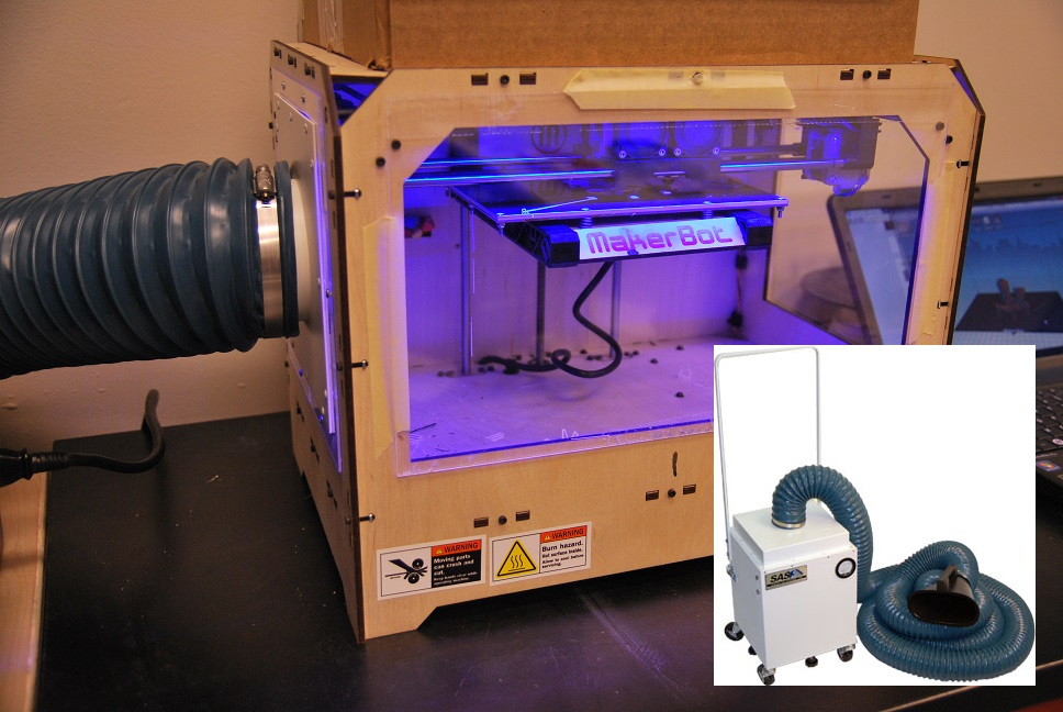 Our Model 300 Portable Floor Sentry with python-style flex hose is shown attached to the side panel of a MakerBot 3D printer at the Children's Museum of Houston's Maker Annex.