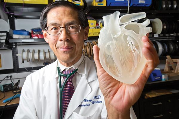 Photo Source: www.bizjournals.com - This resin heart, held by Stanford cardiologist Dr. Paul Wang, is the product of 3-D printing technology that may help advance medical breakthroughs.