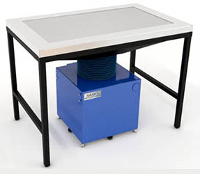 Operate devices in development on this bench while the powerful fan/filter chassis pulls contaminants away from the product and the engineers who circle it, down into filtration media that prevent diffusion through the lab. Filtered air is returned to the room.
